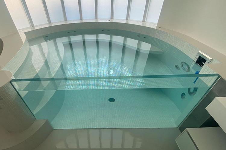 Spectacular hot tubs bathroom tiled in mosaic
