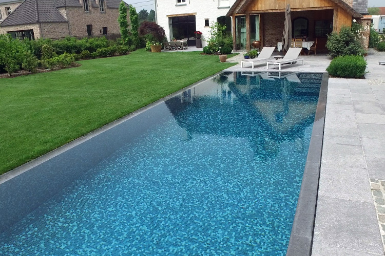 A grey mosaic tile mix for a swimming pool in northern Belgium